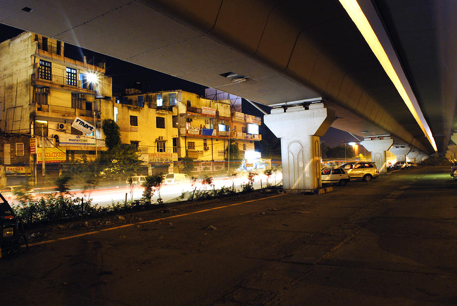 Traffic Running Beneath Flyover Photograph