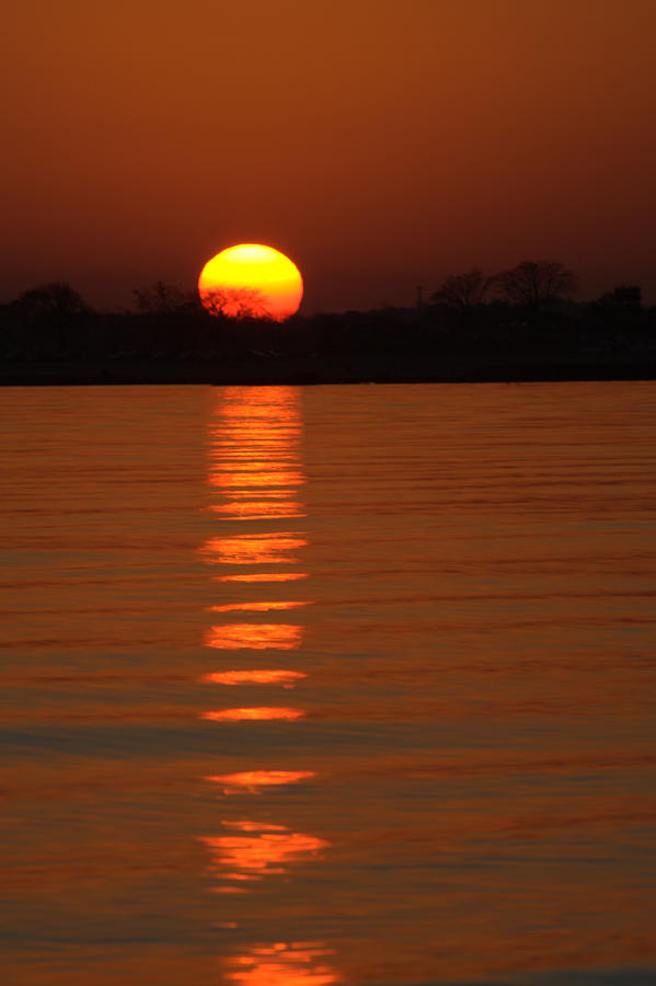 Sunset Photograph - Trailing Sun by Karol Livote