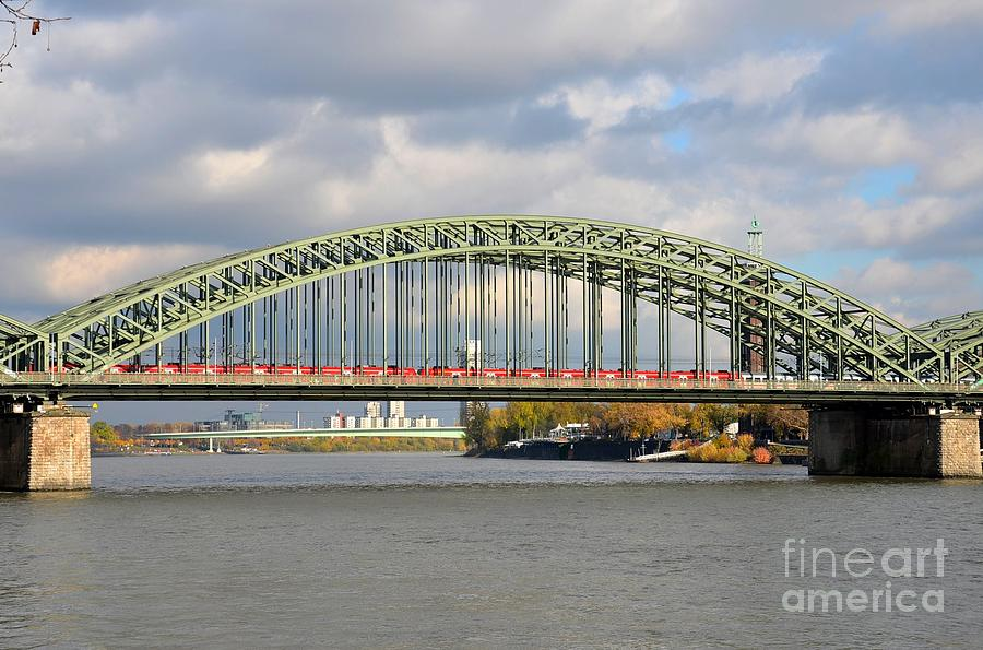 Train on bridge at rhine river cologne germany photograph