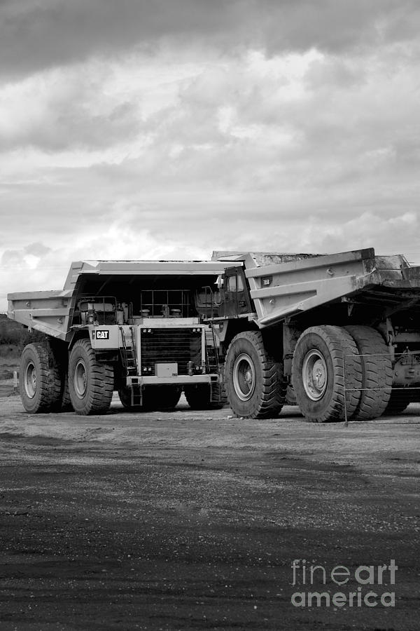 Twin Caterpillar Trucks Photograph