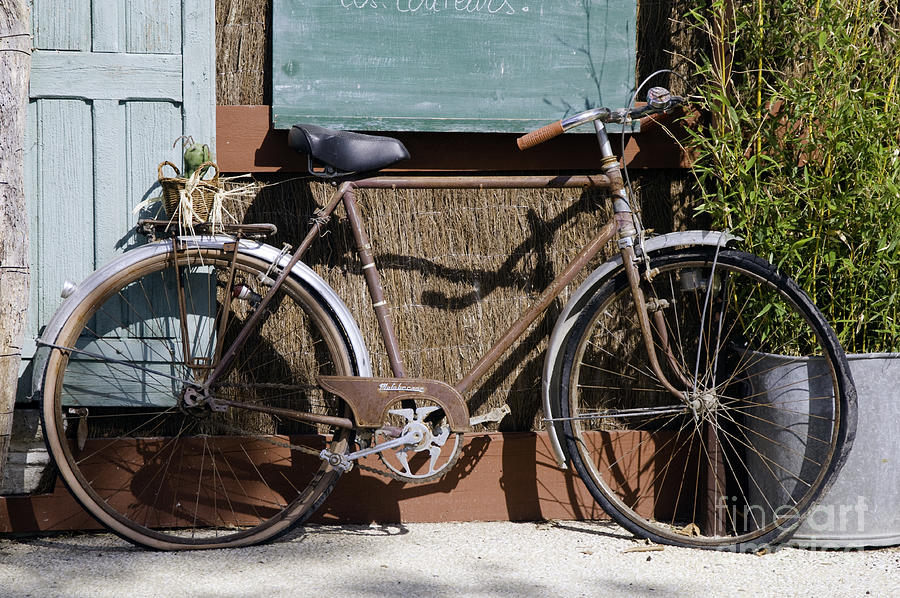 Rustrel France Old Bicycle Bicycles City Cities Cityscape Cityscape Provence Bike Bikes Photograph - Twin Flats by Bob Phillips