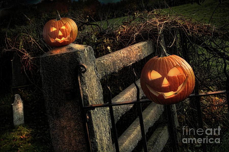 Celebration Photograph - Two Halloween Pumpkins Sitting On Fence by Sandra Cunningham