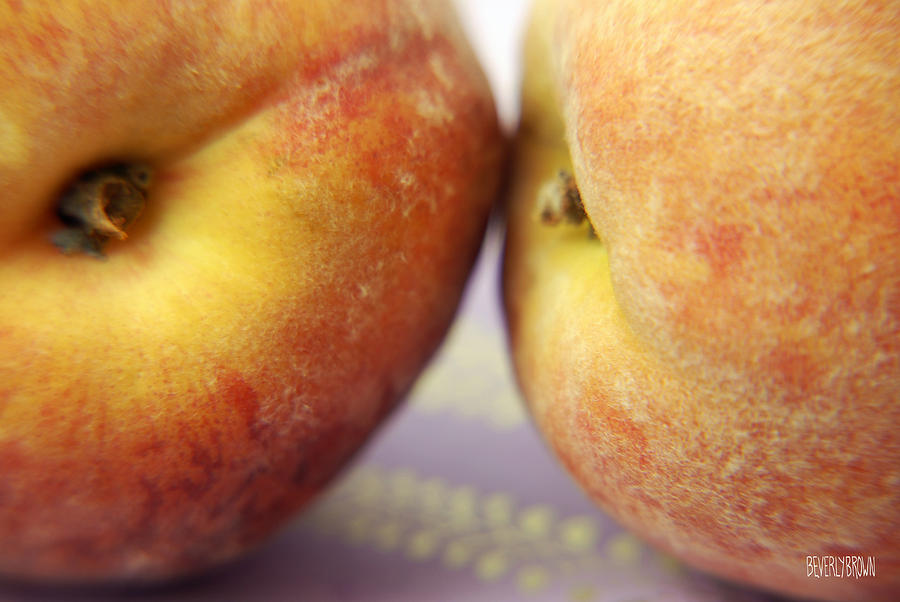 Two Peaches On A Purple Background Photograph