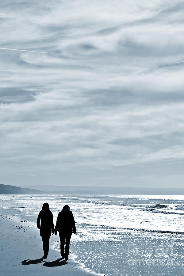 Two Women Walking At The Beach In The Winter Photograph