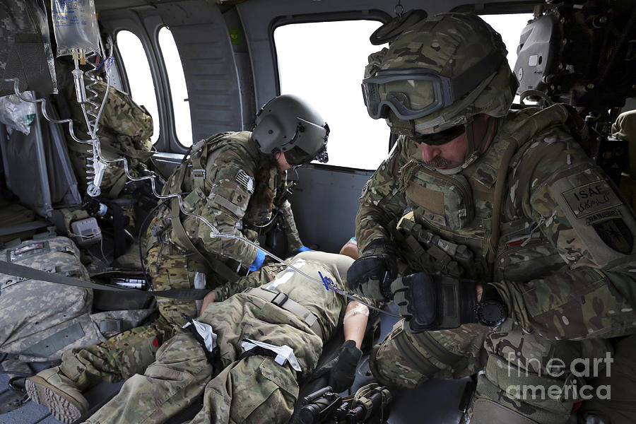 U.s. Army Flight Medics Aid A Simulated Photograph