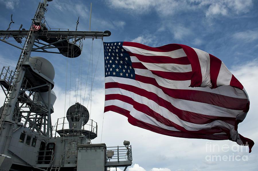 Uss Cowpens Flies A Large American Flag Photograph