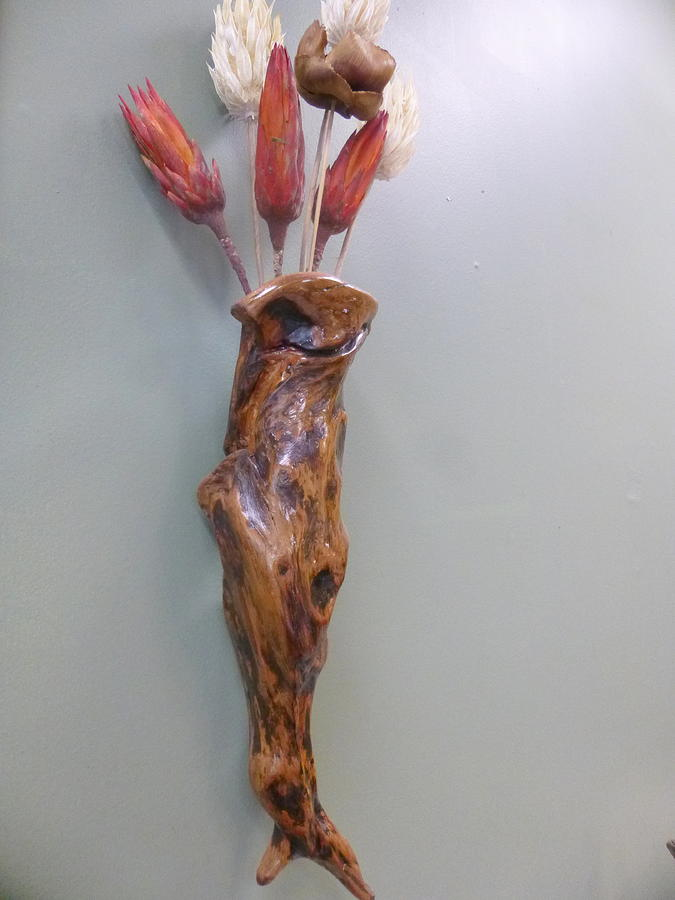 Vase With A Face Sculpture