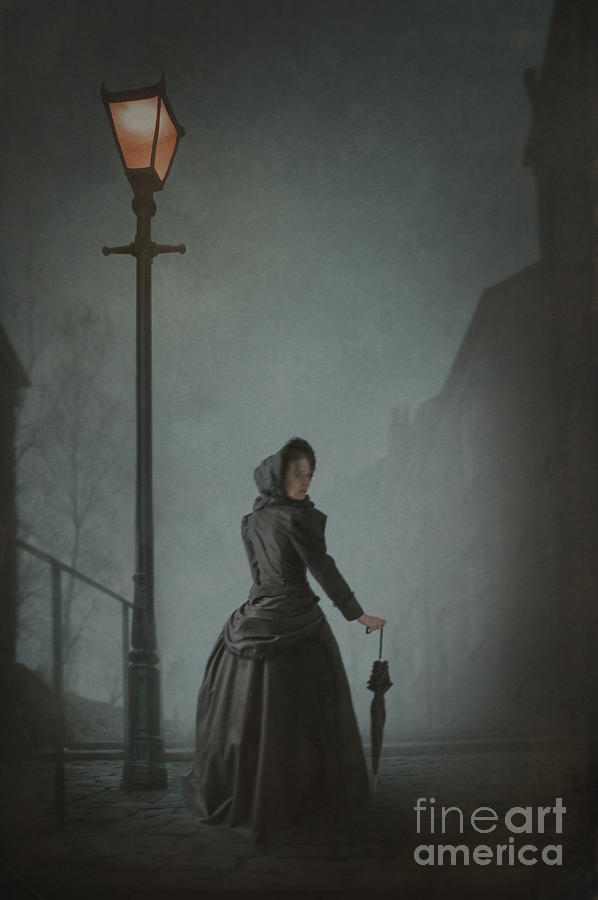 Victorian Woman Under Streetlamp In Fog Photograph