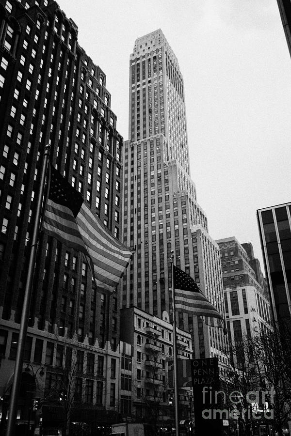 view of pennsylvania bldg nelson tower and US flags flying on 34th street from 1 penn plaza new york Photograph