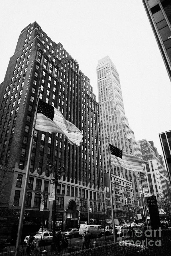 view of pennsylvania bldg nelson tower and US flags flying on 34th street new york city Photograph