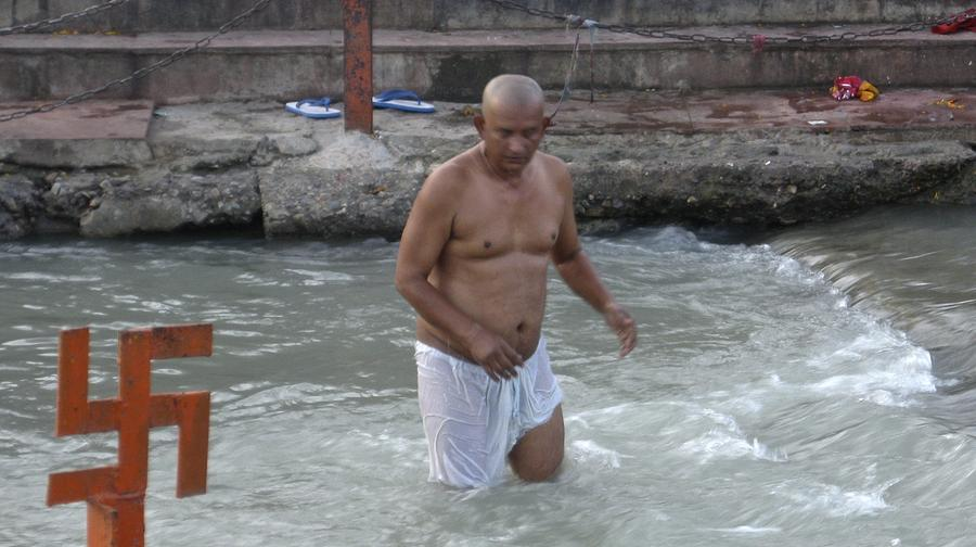 Wading At The River Ganges Photograph