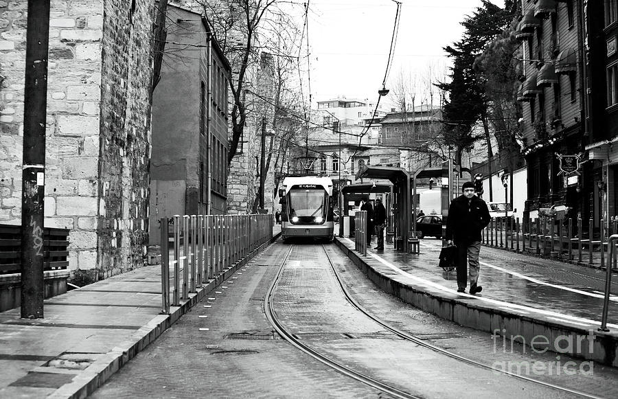Waiting For The Tram In Istanbul Photograph - Waiting For The Tram In Istanbul by John Rizzuto