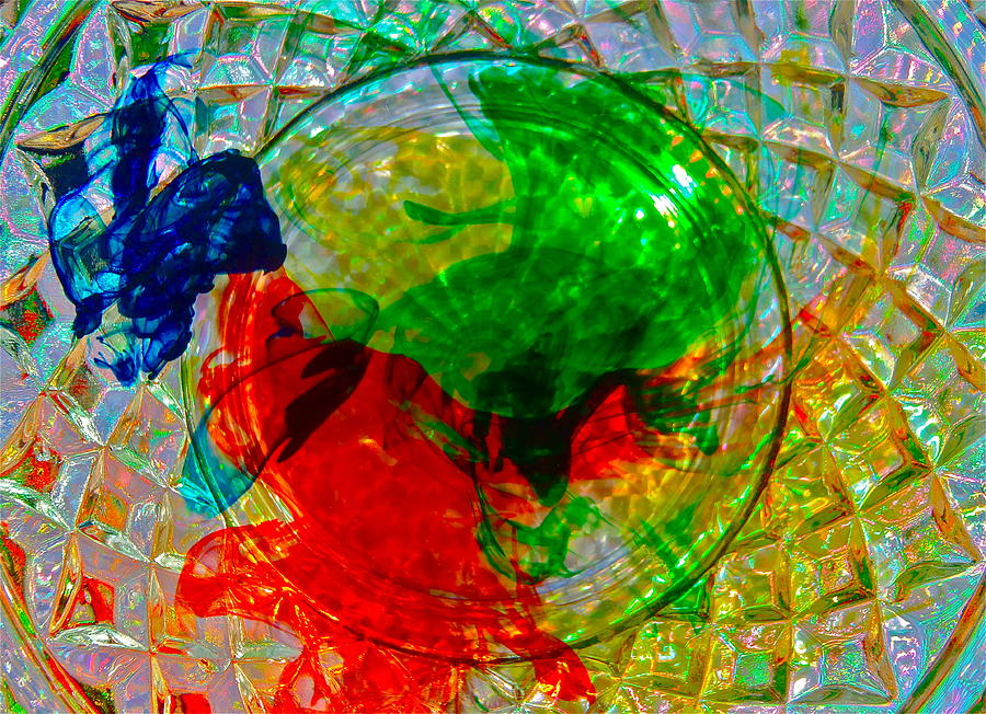 Water With Food Coloring In Glass On Placemat by Rob Michels