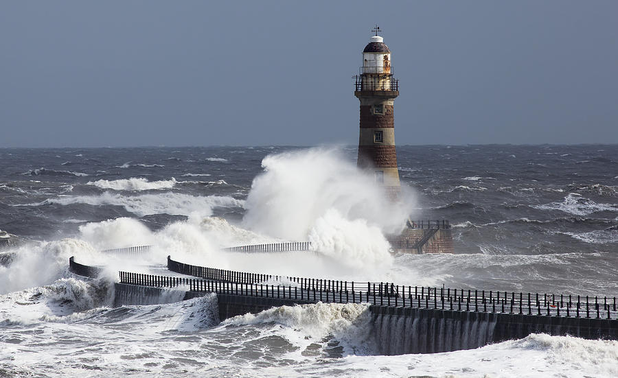 Waves Crashing Into A Lighthouse Photograph by John Short