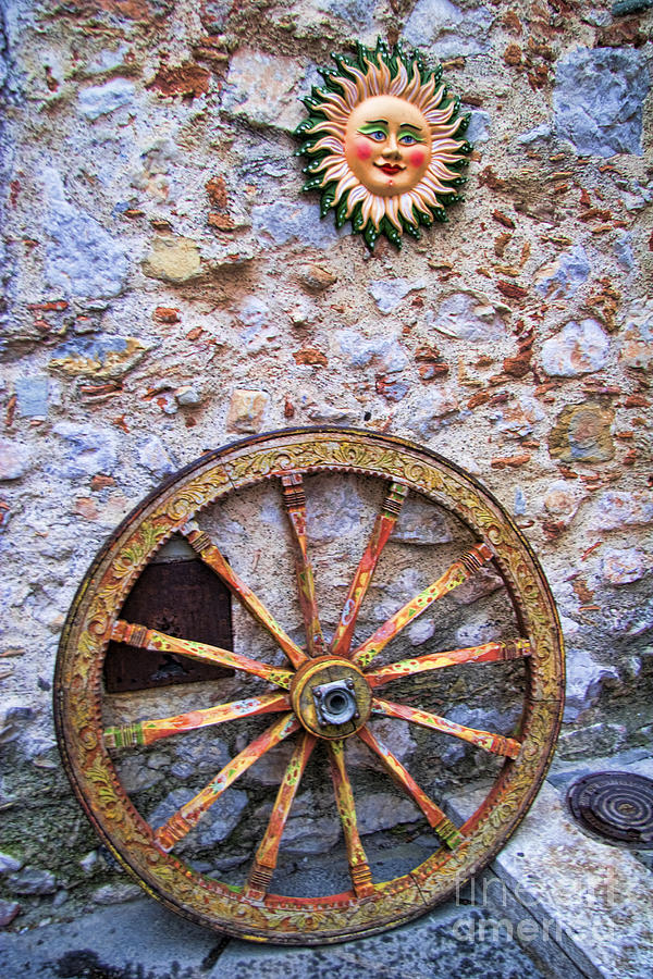 Wheel And Sun In Taromina Sicily Photograph