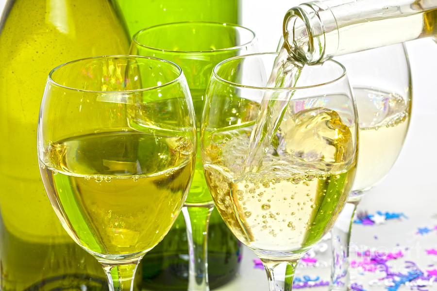 White Wine Pouring Into Glasses Photograph
