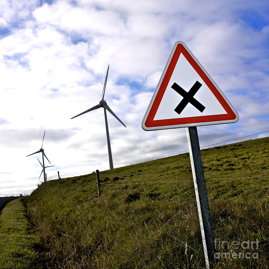Wind Turbines On The Edge Of A Field With A Road Sign In Foreground. Photograph