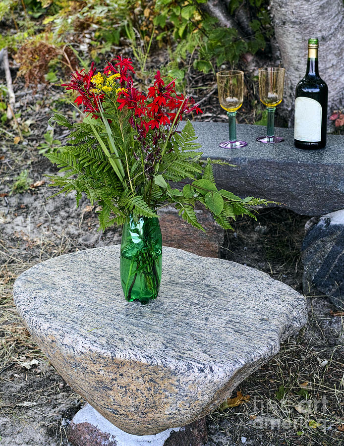 Wine And Red Flowers On The Rocks Photograph