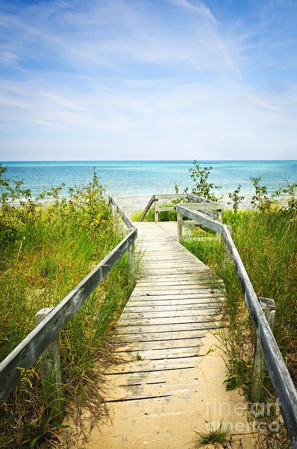 Wooden Walkway Over Dunes At Beach Photograph