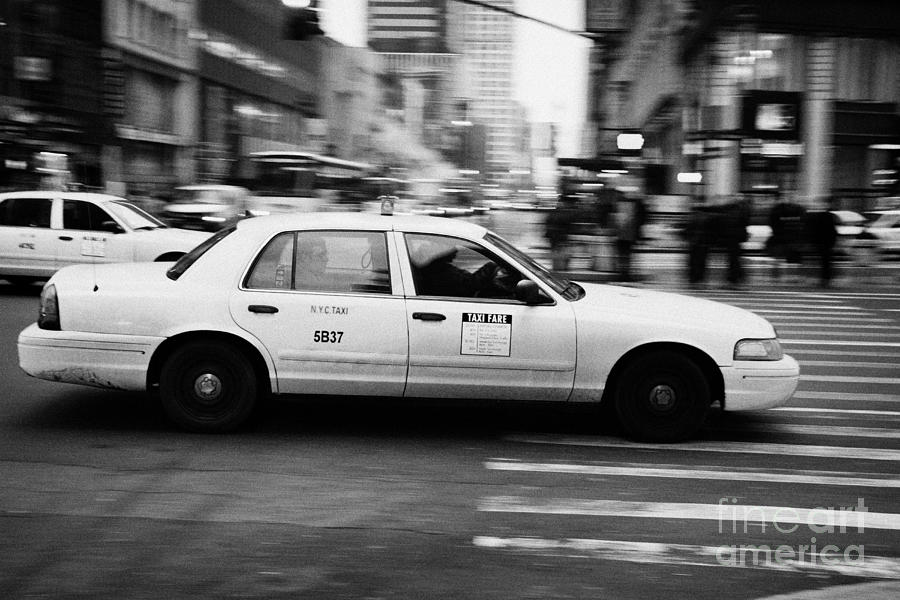 Usa Photograph - Yellow Cab Blurring Past Crosswalk And Pedestrians New York City Usa by Joe Fox