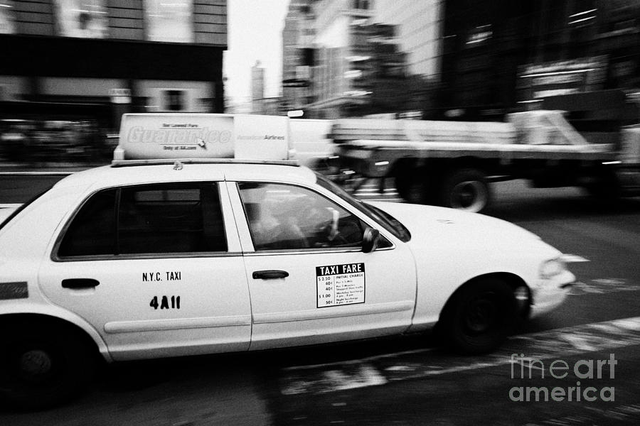 Yellow Cab With Advertising Hoarding Blurring Past Crosswalk And Pedestrians New York City Usa Photograph