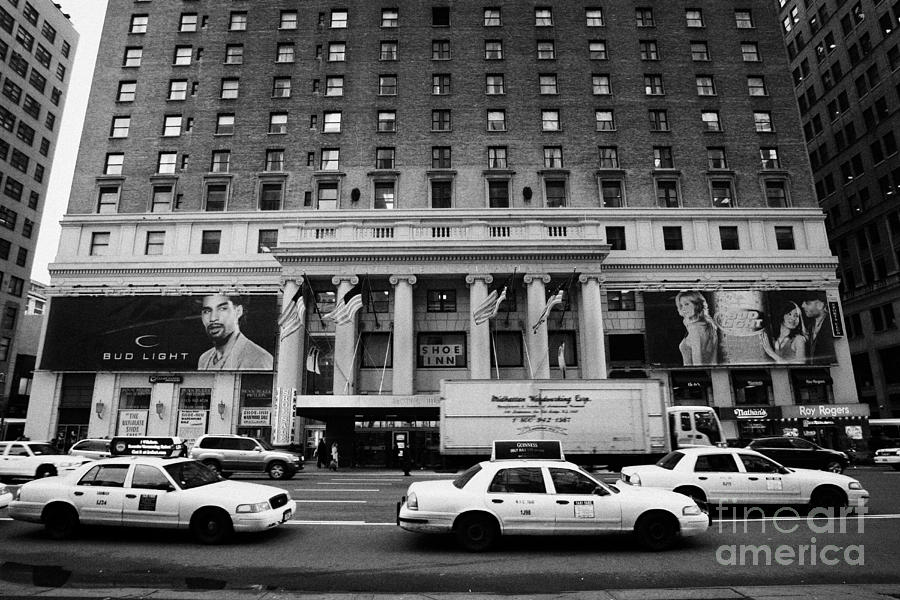 Usa Photograph - Yellow Cabs Go Past Pennsylvania Hotel On 7th Avenue New York City Usa by Joe Fox