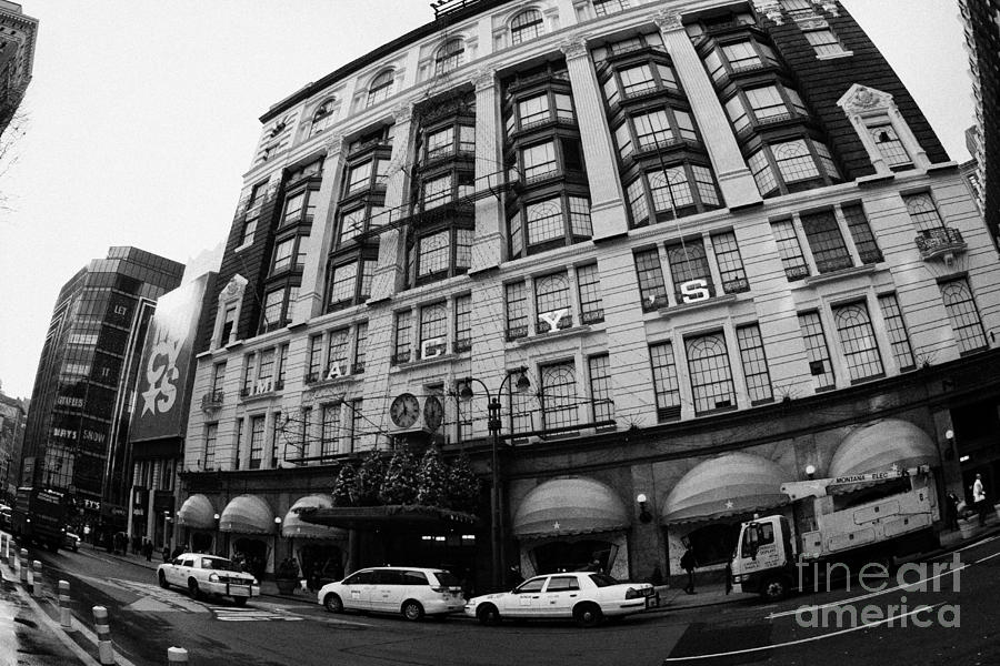 yellow cabs wait outside Macys at Broadway and 34th Street Herald Square new york Photograph