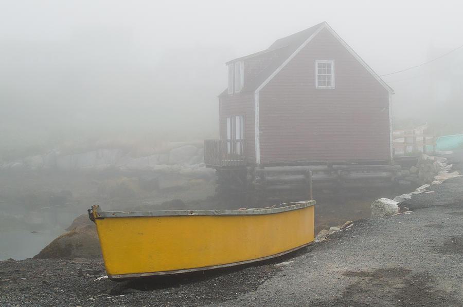Yellow Canoe In The Fog Photograph