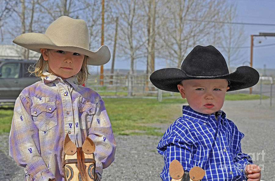 Young Cowboy And Cowgirl Stick Ponies Photograph