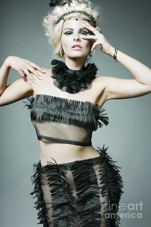 Young Fashion Model Wearing Designer Dress. Photograph