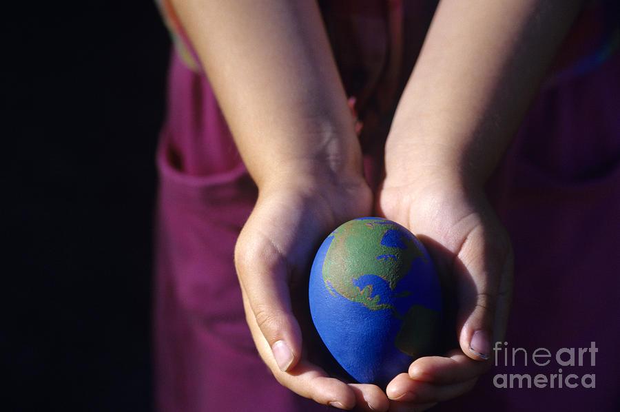Young Girl Holding Earth Egg Photograph