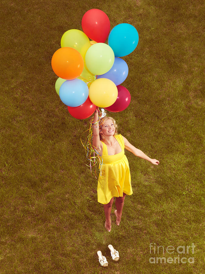 Young Happy Woman Flying On Colorful Helium Balloons Photograph