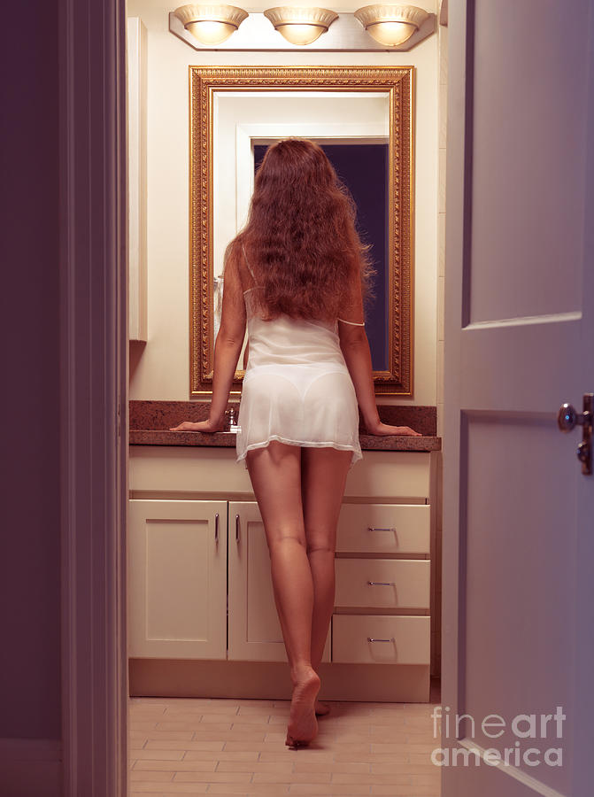 Young Sexy Woman At A Bathroom Mirror Photograph by Oleksiy Maksymenko