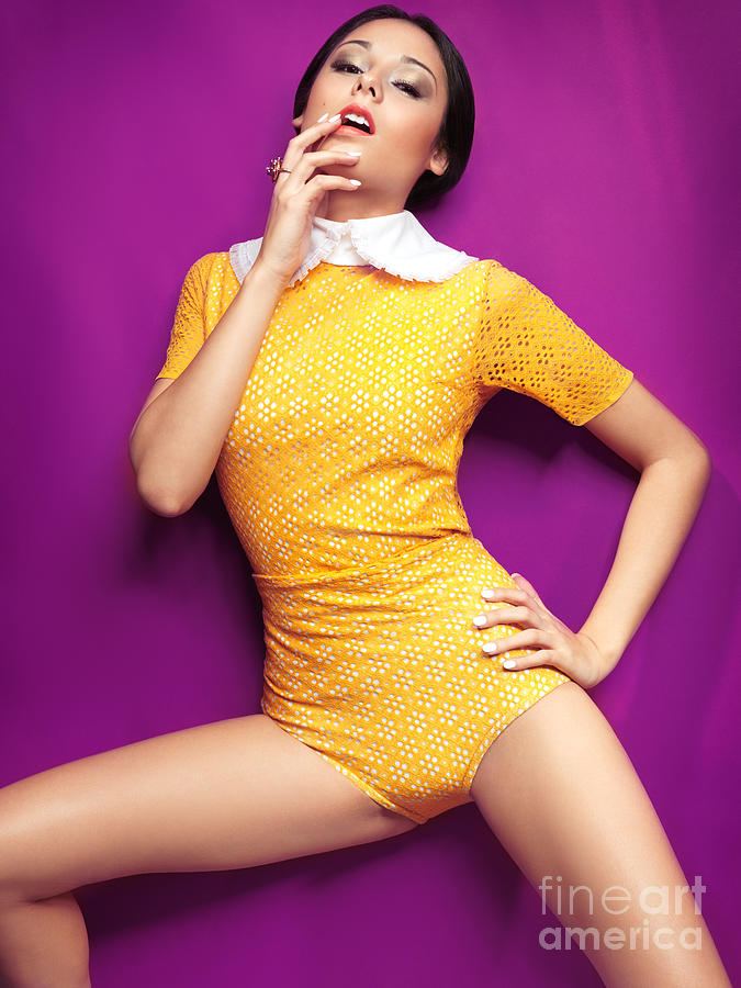 Young Woman In Bright Yellow Vintage Style Clothes Photograph