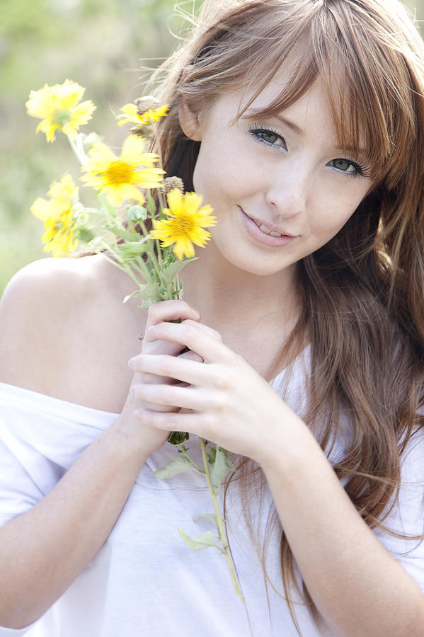 Young Woman With Flowers Photograph