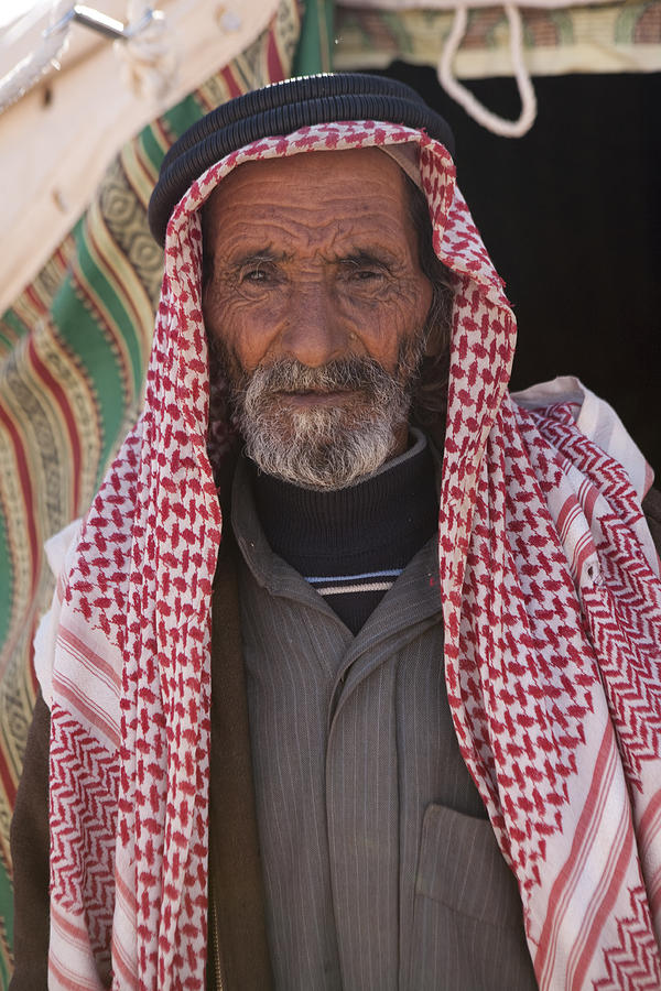 A Bedouin Man At The Camera In Front Photograph