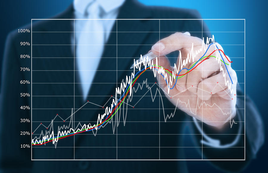 Businessman Writing Graph Of Stock Market  Photograph
