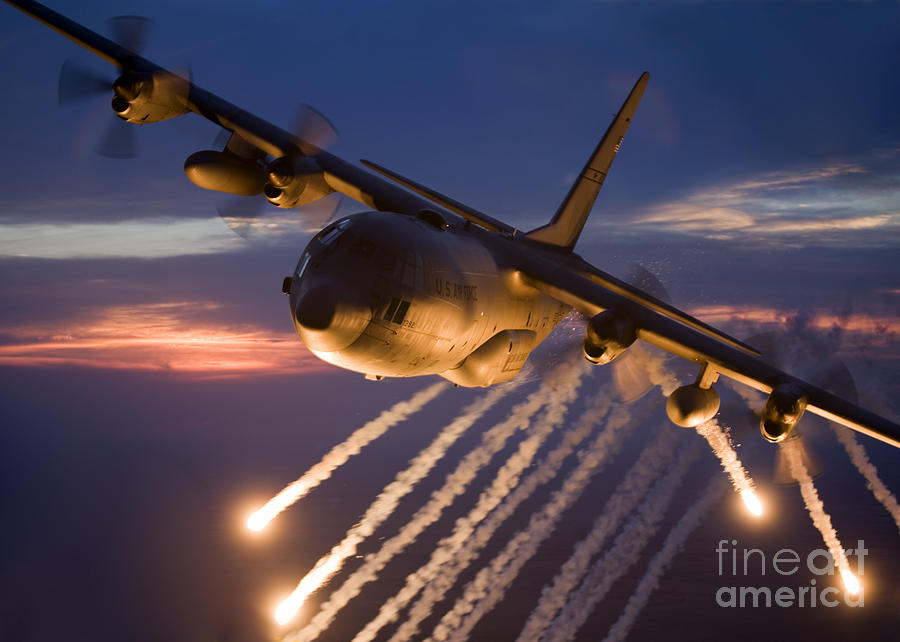 A C-130 Hercules Releases Flares Photograph