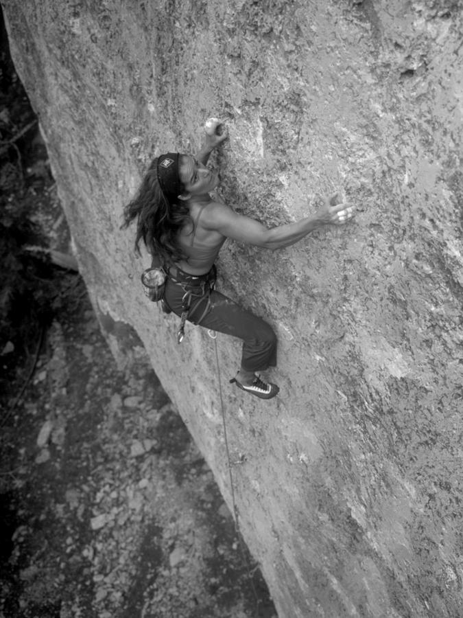 A Caucasian Women Rock Climbing Photograph