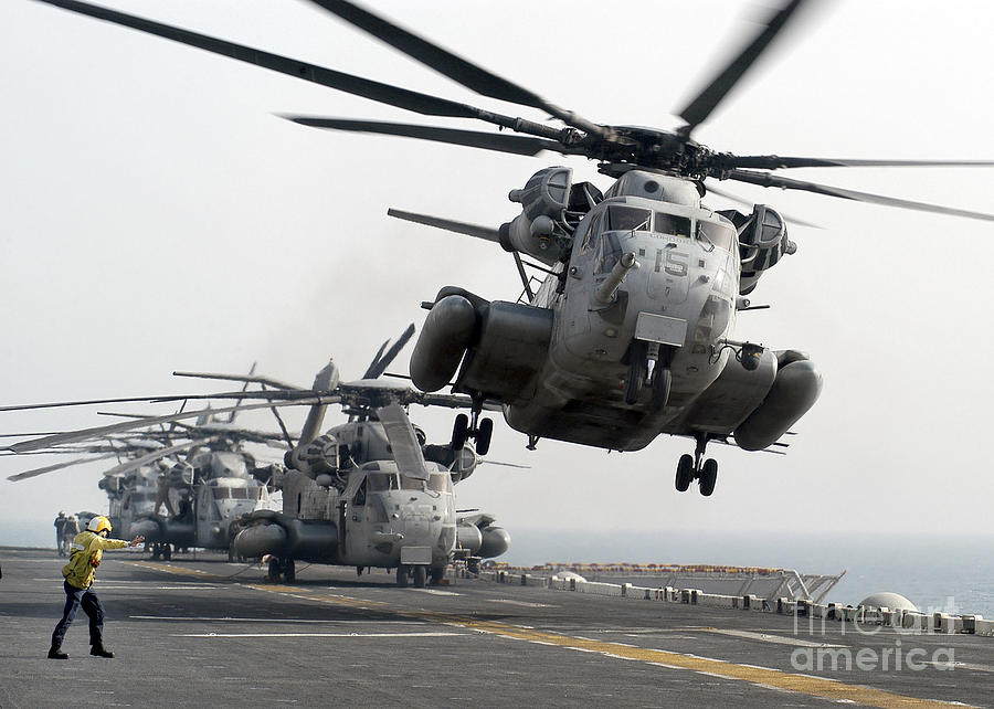 A Ch-53e Super Stallion Lifts Photograph