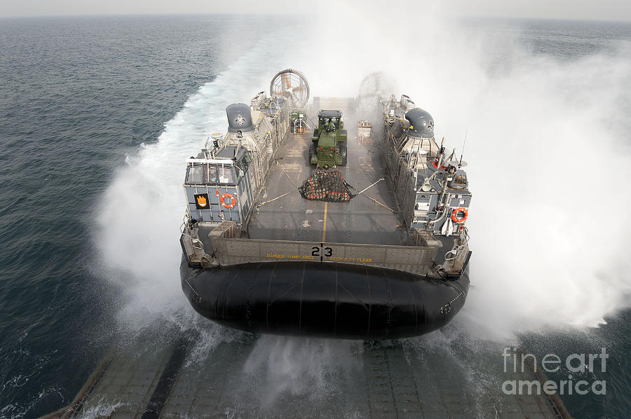 Military Photograph - A Landing Craft Air Cushion Enters by Stocktrek Images