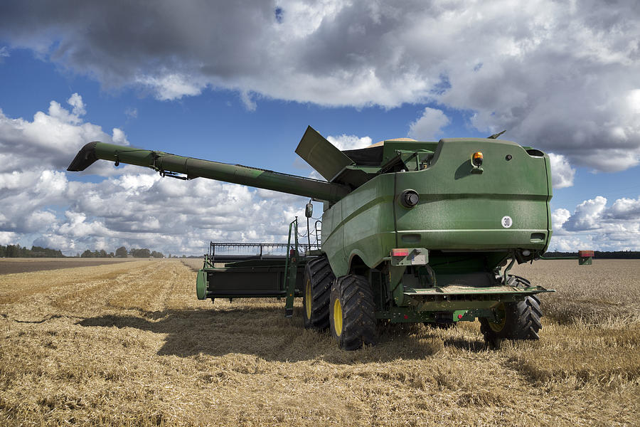 A Large Combine Harvester Machinery Photograph