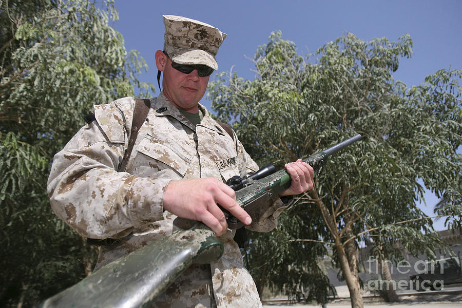 A Soldier Holds The M-40a1 Sniper Rifle Photograph