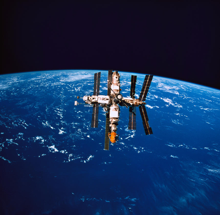 A Space Station In Orbit Above The Earth Photograph  - A Space Station In Orbit Above The Earth Fine Art Print