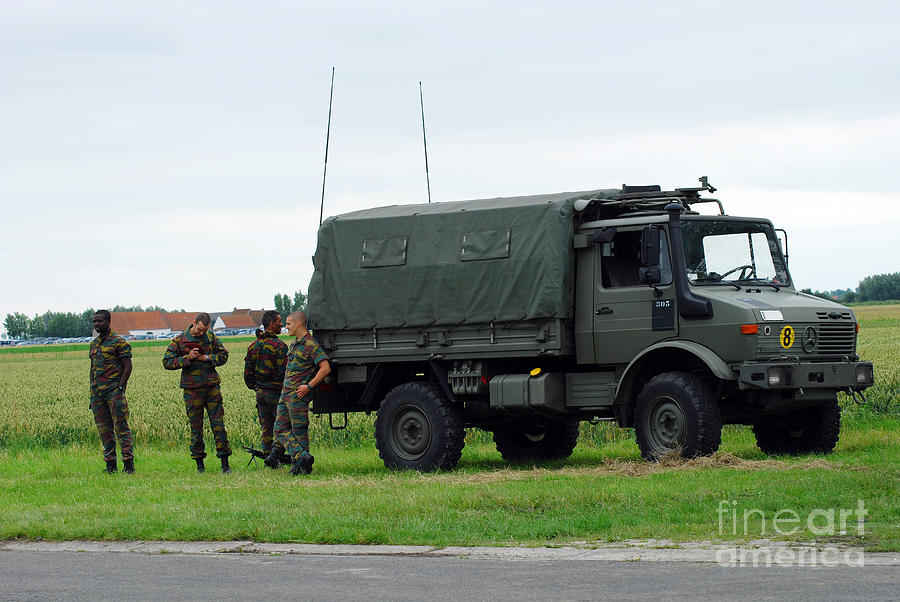 Belgium Photograph - A Unimog Vehicle Of The Belgian Army by Luc De Jaeger