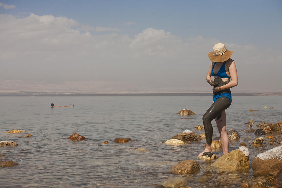 A Woman Smears Therapeutic Dead Sea Mud Photograph  - A Woman Smears Therapeutic Dead Sea Mud Fine Art Print