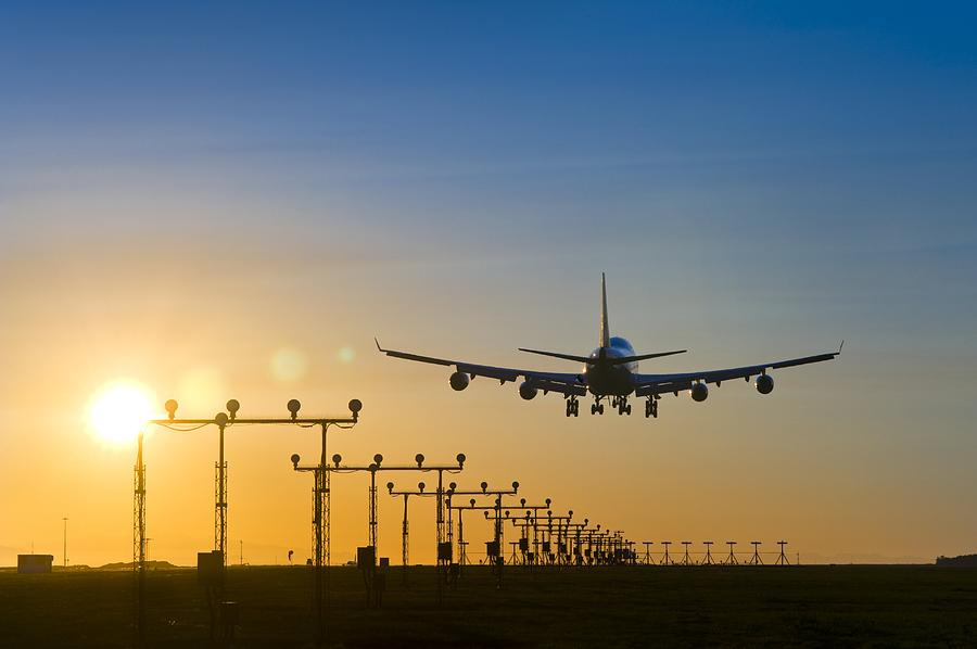 Aeroplane Landing At Sunset, Canada Photograph