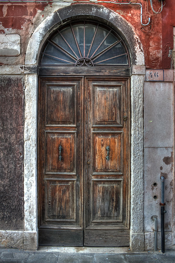 an old wooden door in Italy Photograph