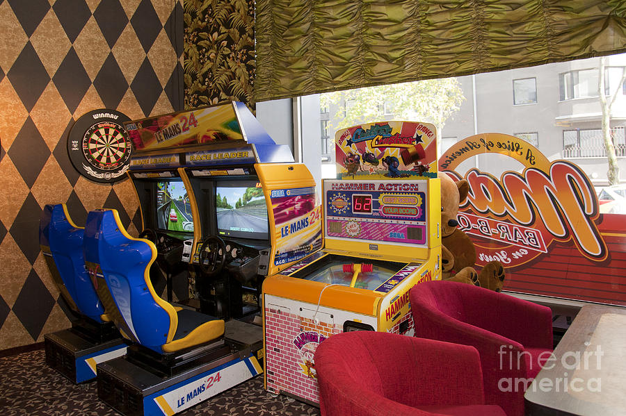 Arcade Game Machines At A Diner Photograph