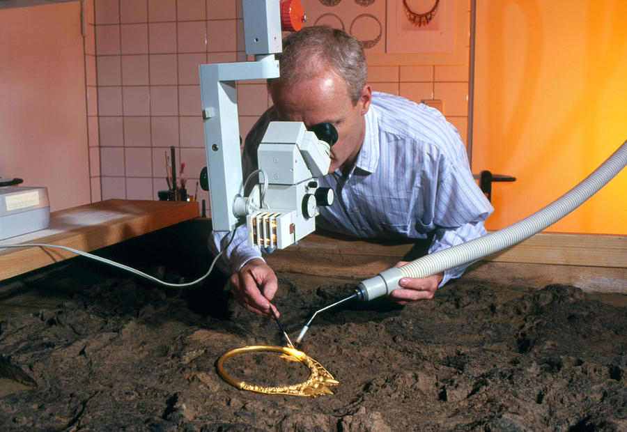 Archaeologist Cleaning A Golden Celtic Necklace Photograph